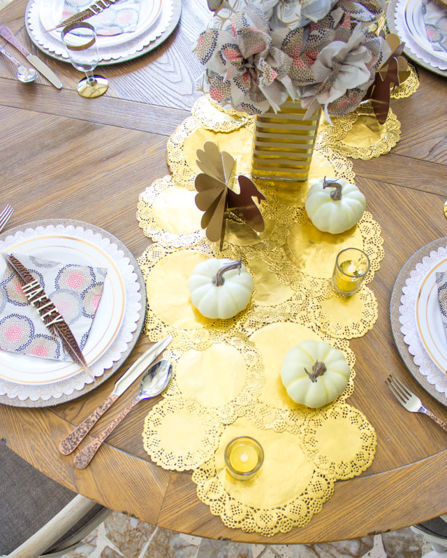Make a beautiful DIY table runner out of gold doilies - so easy and inexpensive!