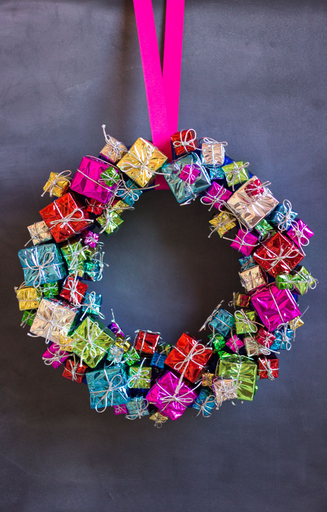Create this gorgeous Christmas wreath with inexpensive present ornaments from the craft store!