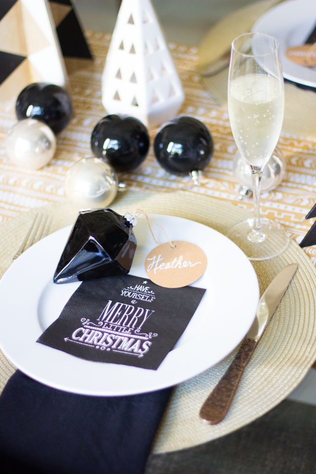 Modern Christmas brunch table with black and white ornaments