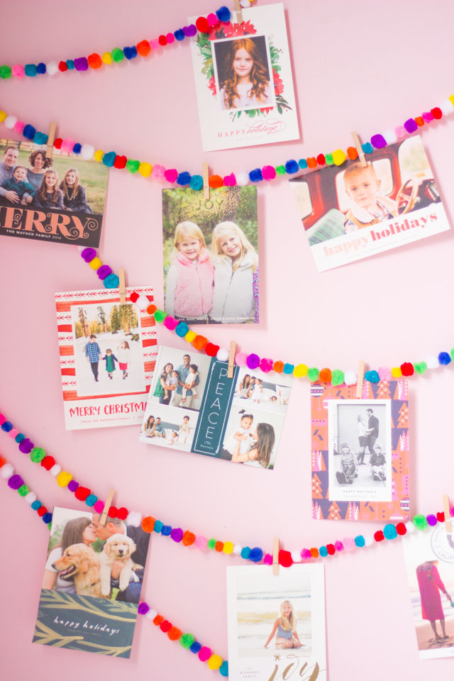 Love this colorful Christmas card display idea with pom-pom garlands!