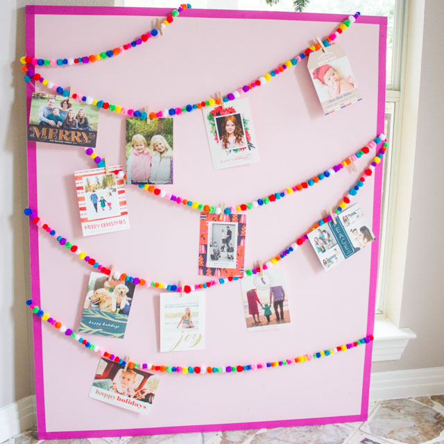 Love this simple and colorful Christmas card holder idea!