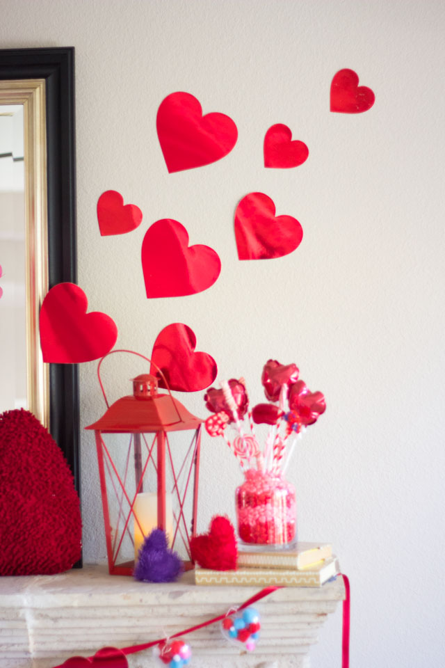Check out this Valentine Mantel decor bursting with hearts!