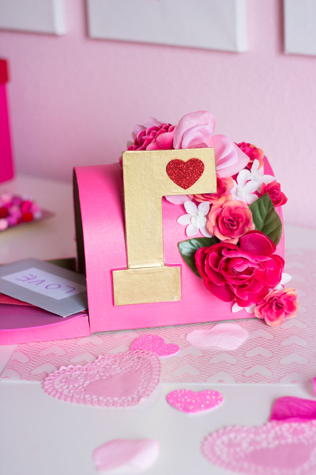 DIY Valentine's Mailbox - such a fun Valentine mailbox idea for girls using a paper mache mailbox and faux flowers!