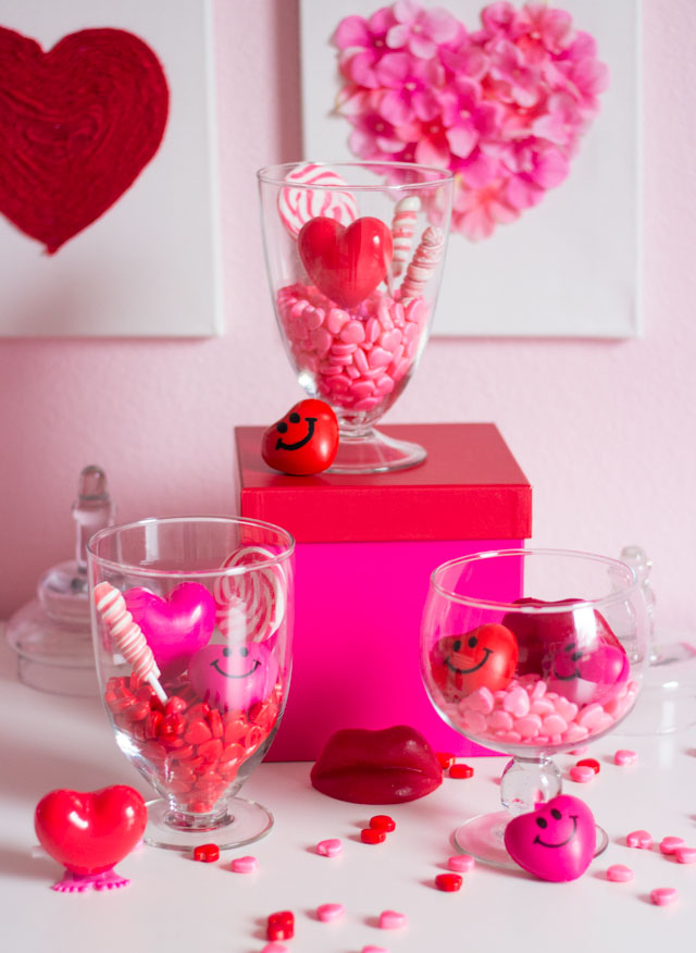 Love this simple and sweet Valentine's Day decoration - candy terrariums!