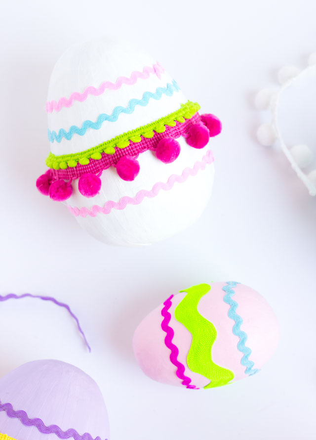 Love these giant Easter eggs decorated with rick rack and pom pom trim!