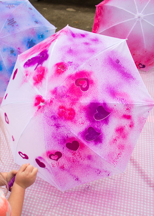 Make DIY kids umbrellas in a rainbow of colors with fabric spray paint!