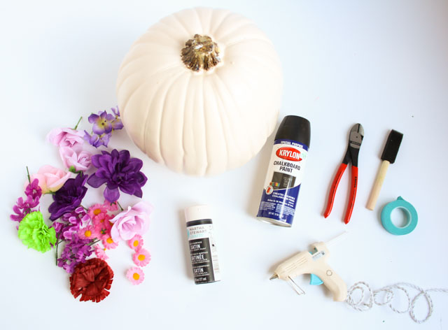 Make these DIY black flower pumpkins with dollar store flowers. The perfect mix of pretty and spooky for Halloween!