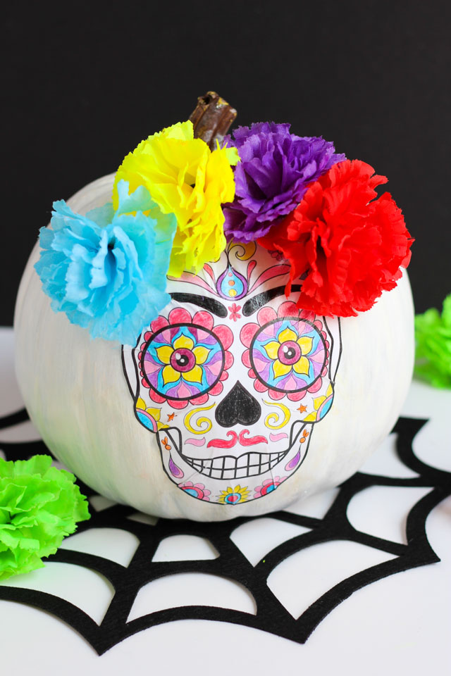 Create this DIY Day of the Dead pumpkin with an adult coloring book page!