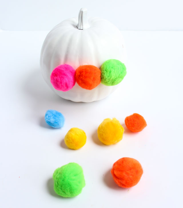 Love this pumpkin decorated with giant pom-poms!