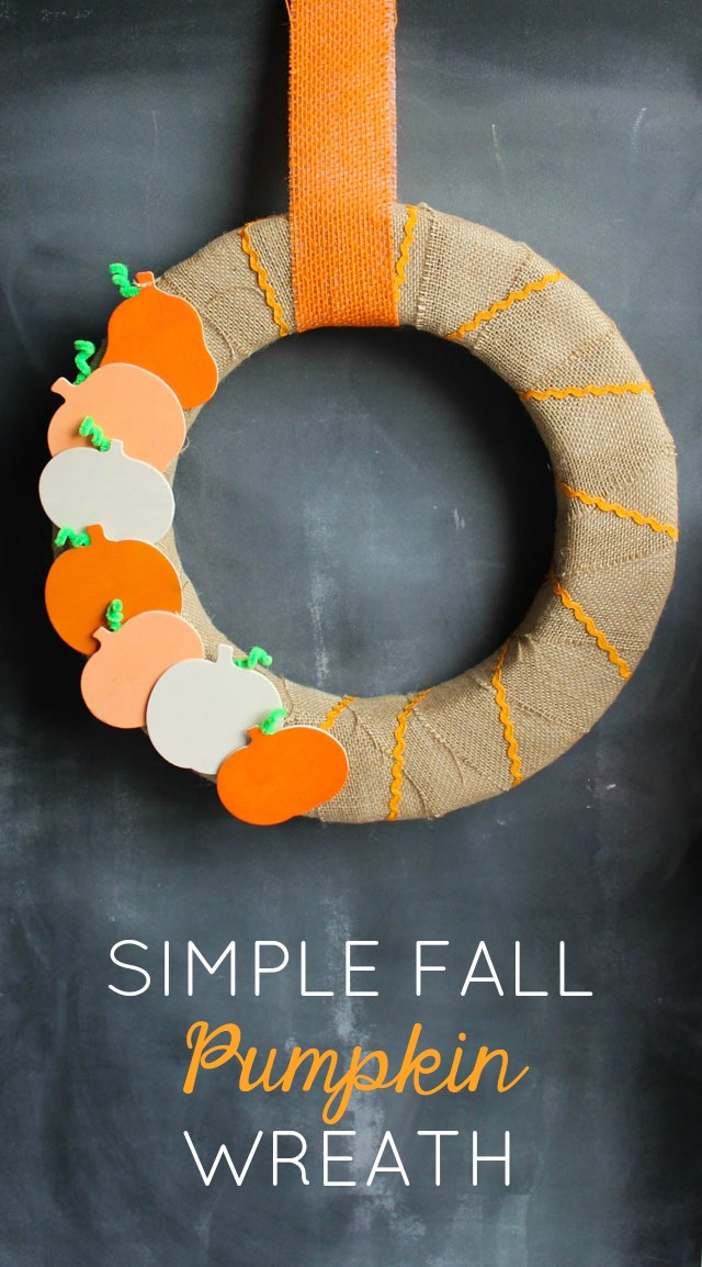 Make this sweet DIY fall pumpkin wreath with painted wood pumpkins and burlap!