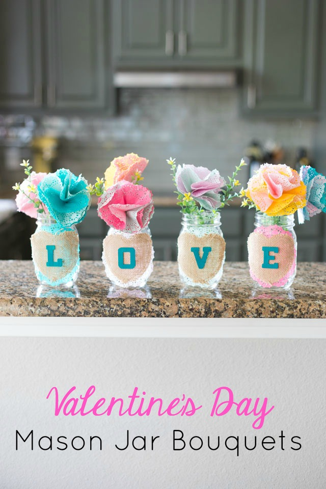 These mason jar bouquets filled with doily flowers are a pretty DIY Valentine's Day decoration or centerpiece! #valentinecrafts #valentinescrafts #masonjarcrafts #doilycrafts #doilyflowers #paperflowers #valentinesdaycrafts