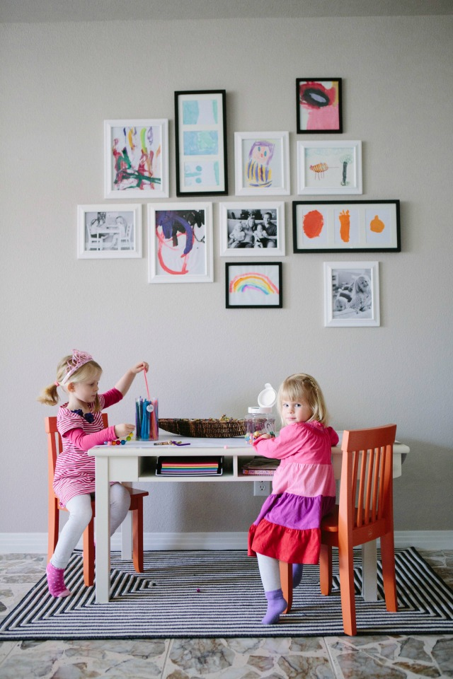 Kids art gallery wall with play table