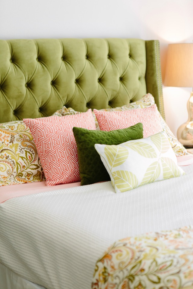 Bed with green tufted headboard