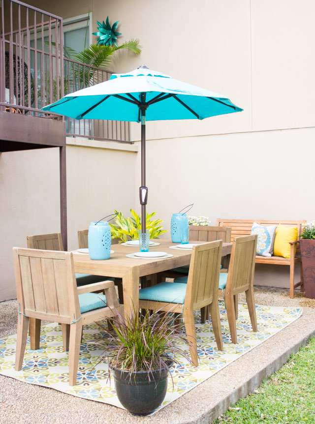 Outdoor patio dining area with umbrella