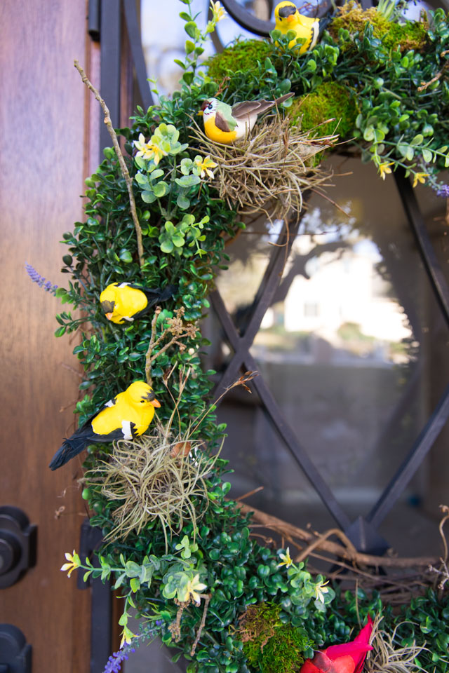 Make a beautiful spring wreath with faux birds, greenery, and nature elements. #birdwreath #springwreath #naturecrafts #birdcrafts