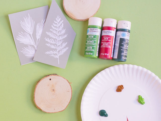 Supplies for DIY stenciled wood sliced ornaments