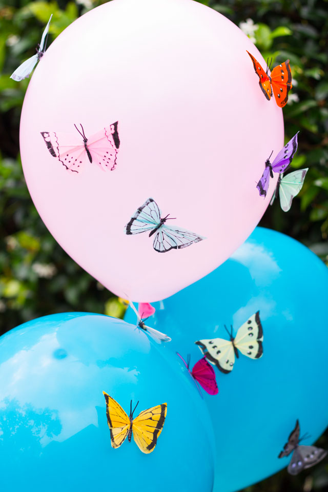Decorate balloons with feather butterflies!