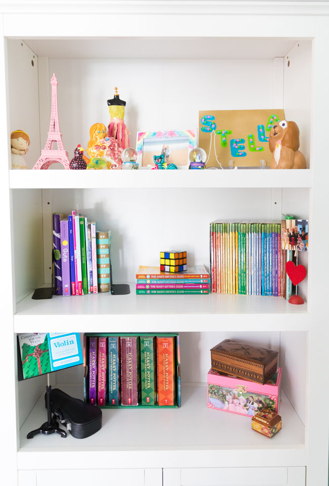 Target white bookcase in girls bedroom
