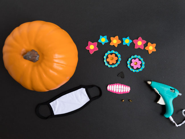 Supplies for Day of the Dead face mask pumpkin