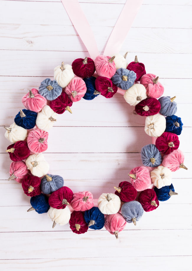 Modern fall wreath with pink and blue velvet pumpkins from Hobby Lobby