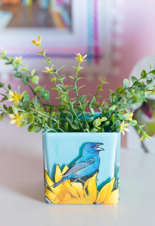 Glass vase painted blue with bird