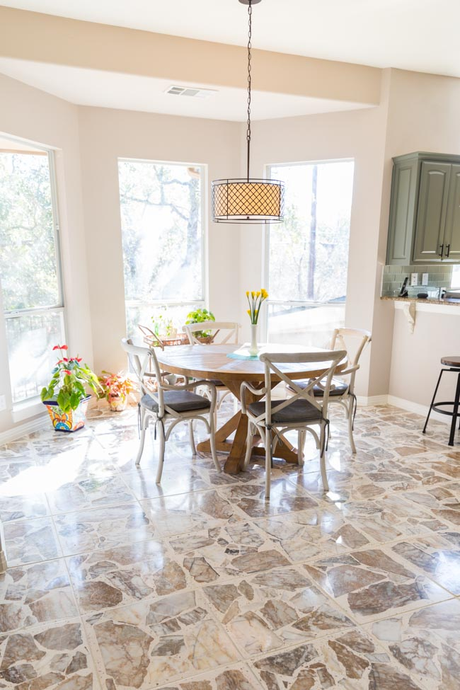 Kitchen with agglomerate stone tiles after tile floor refinishing