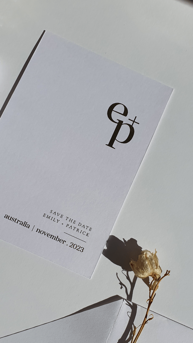 editorial style wedding save the date card with monogram featuring initials E + P