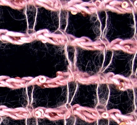 A close up that shows how the yarn end is imperceptibly sewn around the edge stitch of the opening.