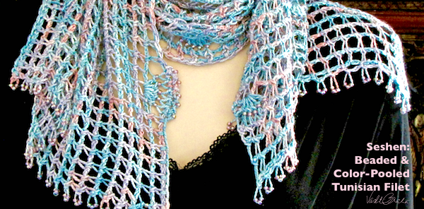 Seshen is a Tunisian filet design in progress. Silk hand dyed yarn that's beaded and color-pooled.