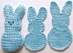 "Two flat crochet bunnies and a stuffed one, all ""marshmallow peeps style"" in light blue Lotus yarn"