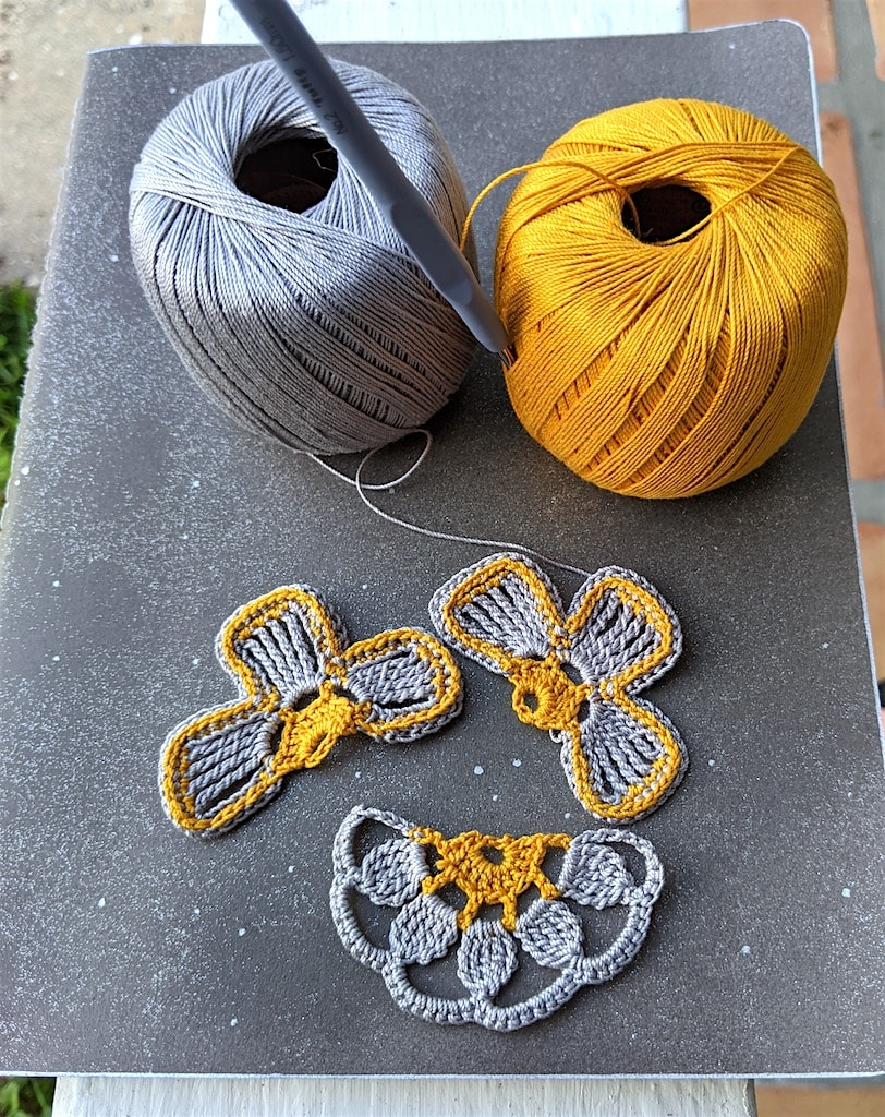The 3 half-flowers in pewter and antique gold colors before sewing Molestine crochet notebook seam