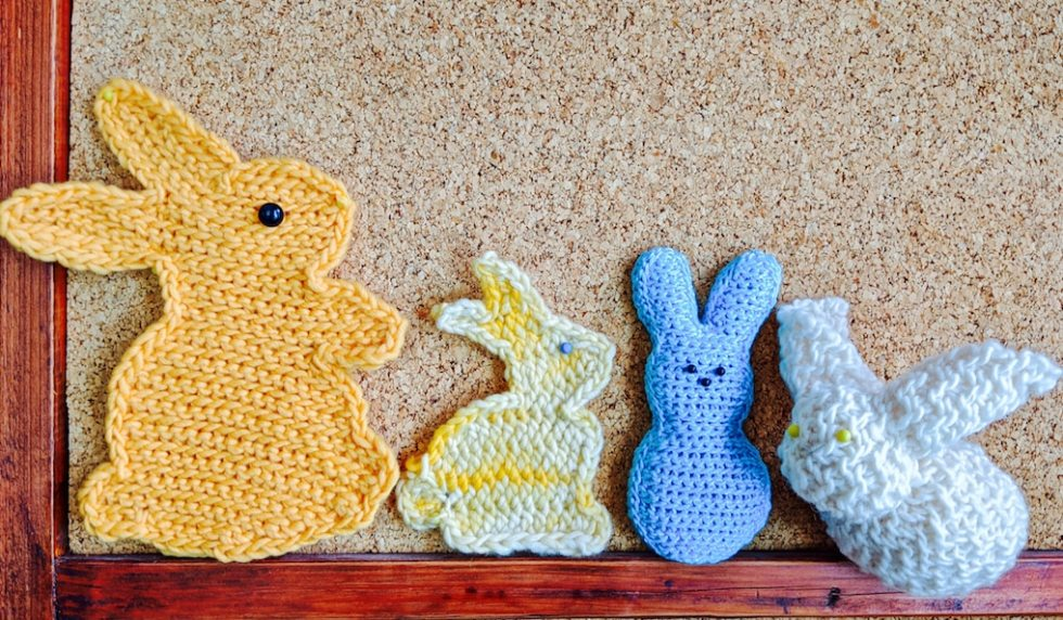 2 flat crocheted bunnies (sihouette), 2 stuffed ones, in different slip stitch crochet textures.