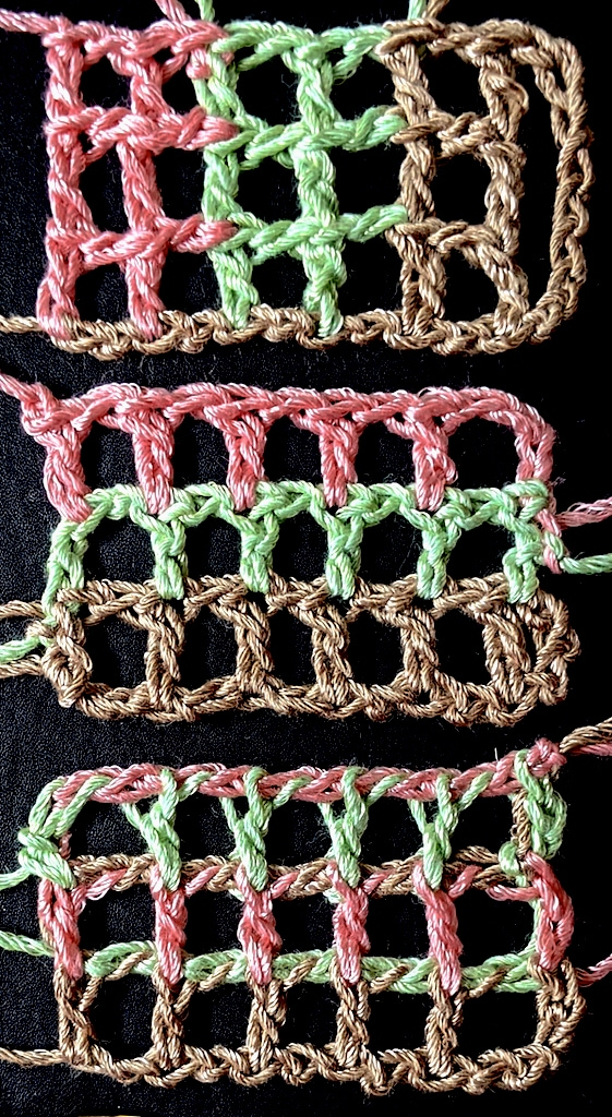 Seemingly simple filet crochet mesh with three colors ending up in very different places.
