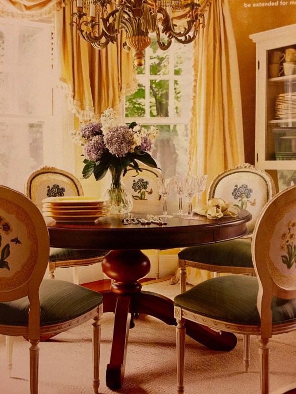 Dining room chairs around a table.
