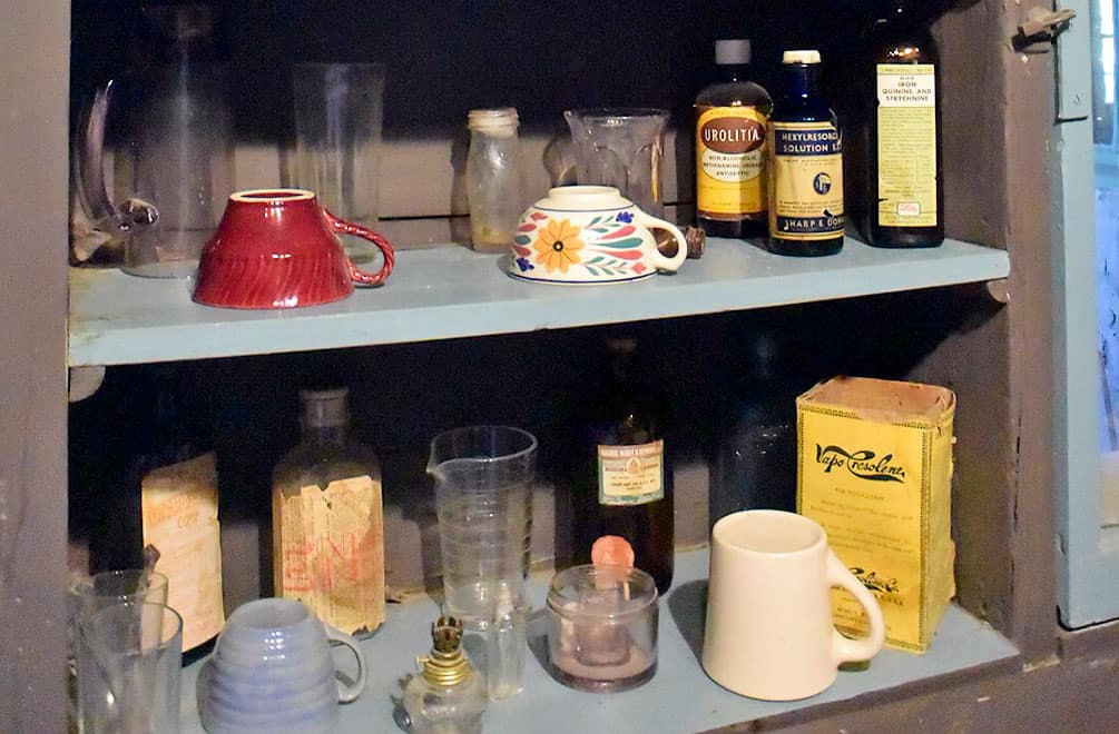 Shelf with cups, bottles and household items at Cabot's Pueblo Museum