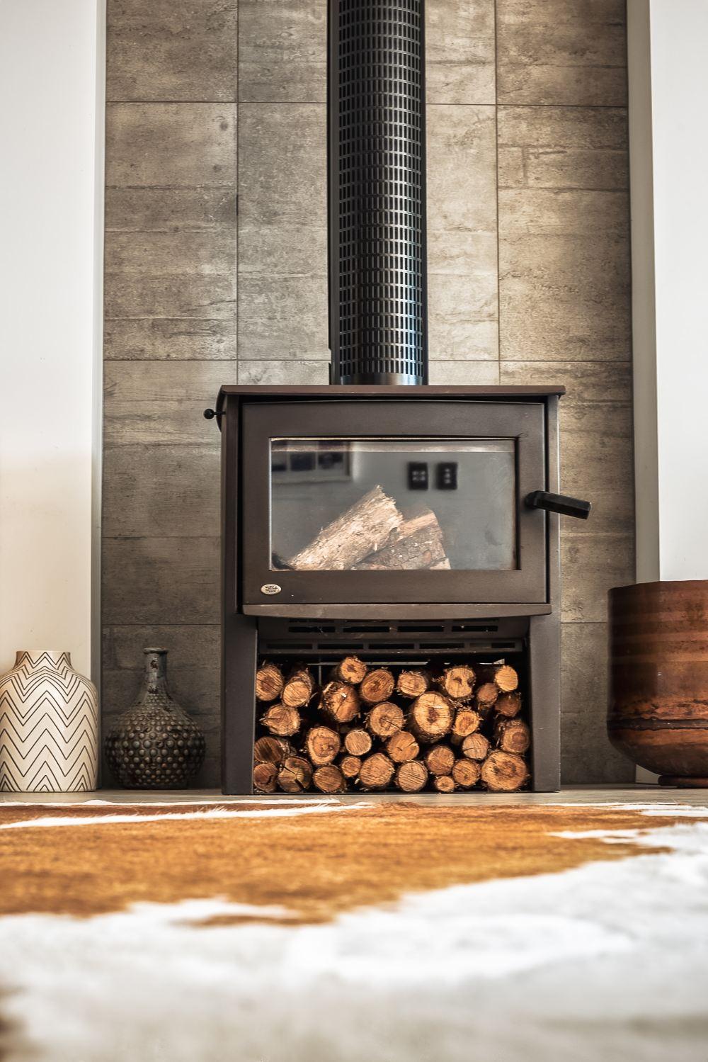 black wood burner near brown wooden pot