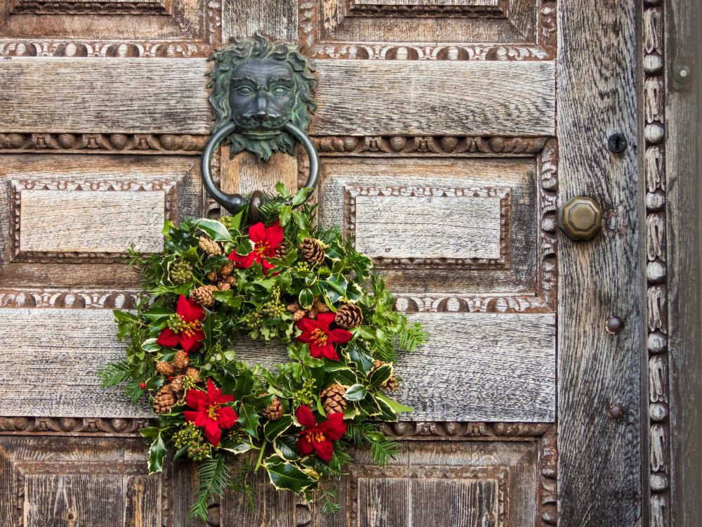 green and red christmas wreath on door knocker