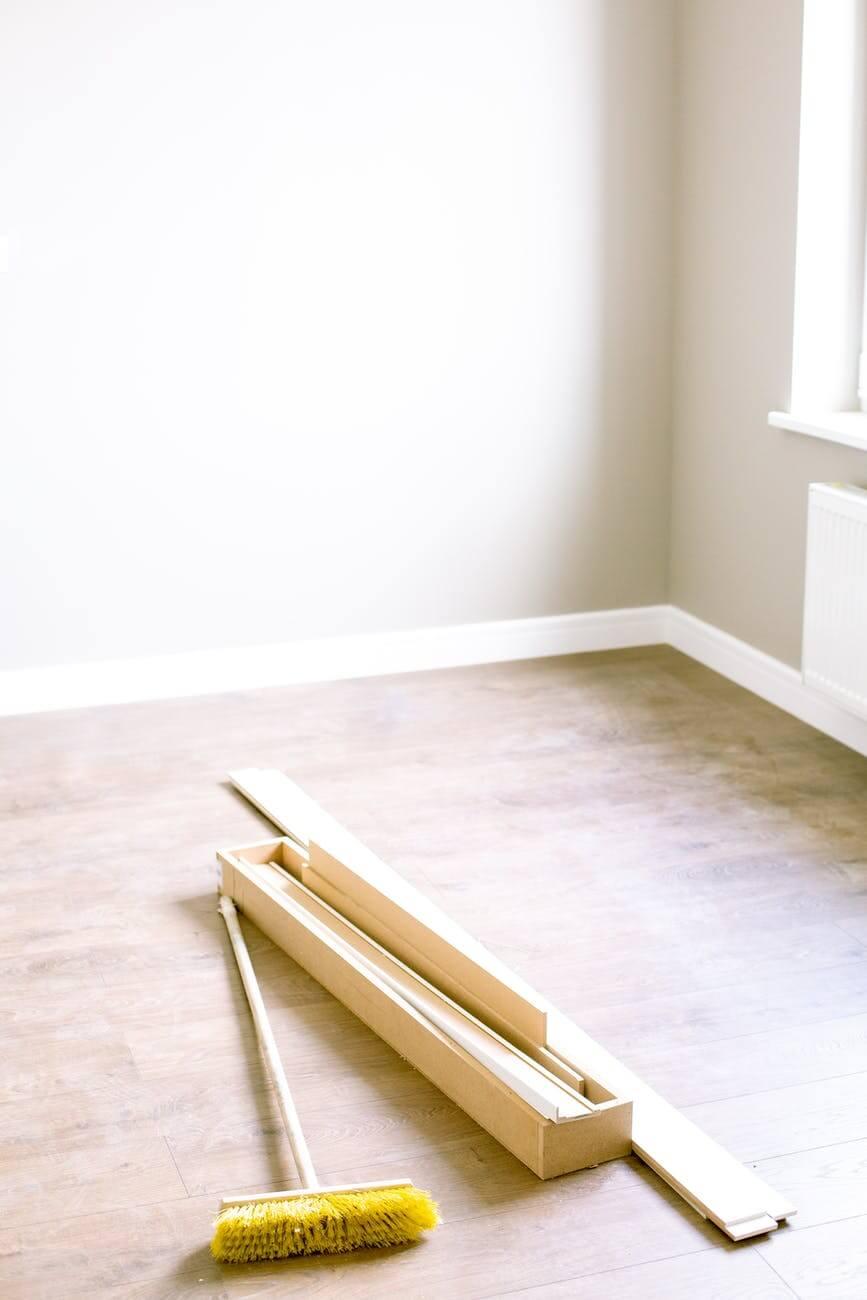 wood planks and floor brush