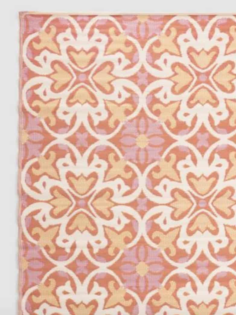 orange and pink medallian rug