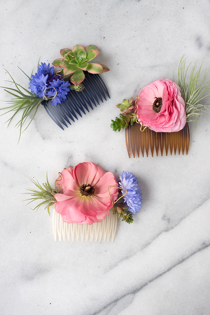 DIY Modern Floral Hair Comb DIY Modern Floral Hair Comb // Design Sponge Supplies Hair comb (I find the plastic kind easier to wear, but any will work) Floral wire Brass wire Succulents Tillandsia Flowers DIY Modern Floral Hair Comb // Design Sponge DIY Modern Floral Hair Comb // Design Sponge Step 1: Begin by choosing what flower you want to build your hair comb around. I went with hardy Bachelor Buttons and just couldn't resist this gorgeous crop of pink Ranunculus. Using a sharp pair of shears, carefully cut the blooms you'd like to use at the base of the stem. DIY Modern Floral Hair Comb // Design Sponge Step 2: Once you have a focal point chosen, it's time to pair it with one of your succulents. I just love how the pink tips of the Echeveria really off set the blue of the Bachelor Buttons, and don't worry if some of the outer leaves have blemishes, you can remove them during assembly. DIY Modern Floral Hair Comb // Design Sponge Step 3: The last ingredient of your modern floral hair comb is of course... a Tillandsia! There's quite a few types of air plants to choose from, I went with a more dramatic, spiky variety for this one, but you could use smaller, more delicate kinds too. DIY Modern Floral Hair Comb // Design Sponge DIY Modern Floral Hair Comb // Design Sponge Step 4: Assemble! Start by cutting a short length of floral wire and piercing your air plant through the base. Next, begin wrapping the wire through the prongs of the hair comb until securely fixed in place. DIY Modern Floral Hair Comb // Design Sponge DIY Modern Floral Hair Comb // Design Sponge Add on your flower and continue wrapping the wire around the comb. Once you're happy with the floral elements, cut any excess floral wire and tuck the end through the base of your succulent. DIY Modern Floral Hair Comb // Design Sponge DIY Modern Floral Hair Comb // Design Sponge Step 5: For the finishing touch, use a pair of needle-nose pliers to bend the copper wire into delicate shapes. I went with simp
