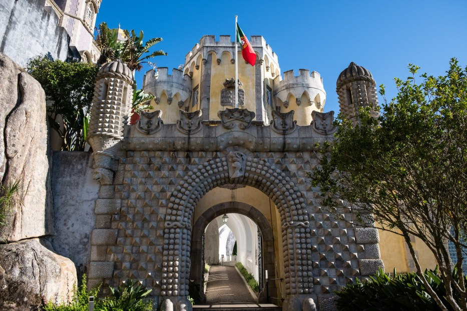 entrance at Pena Palace at sintra with Portuguese flag on top