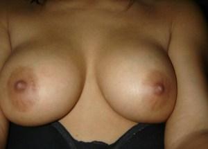 Sexy round naked boobs photo