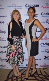 Esther Báez y Giselle Santos