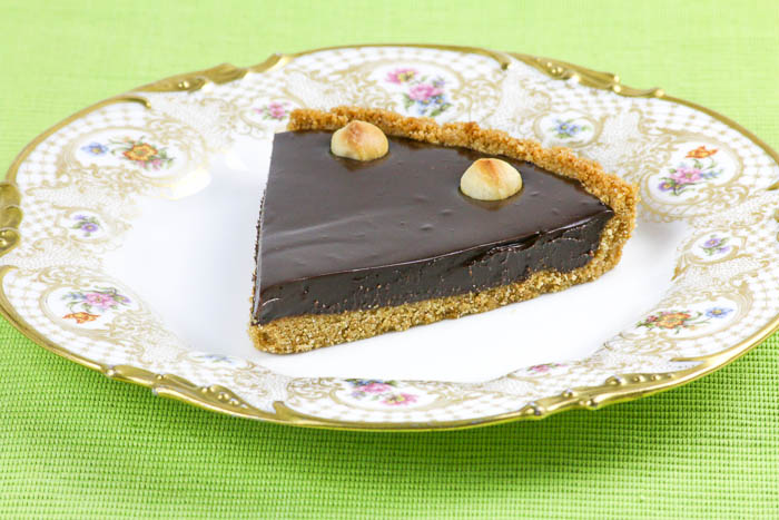 Chocolate Macadamia Nut Tart blends these flavors together for a heavenly dessert. An easy recipe when you want to wow your family.