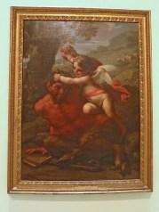 peinture d'un ange jouant avec un satyre