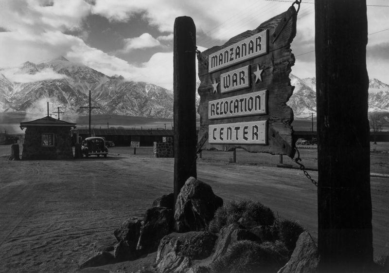 Manzanar Enterance and sign. Photograph by Ansel Adam