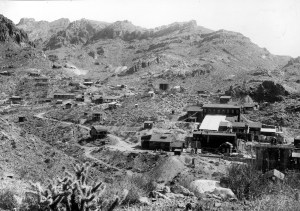 Mines of the Oatman district; Up Gold Road Gulch, showing the surface relations of the Gold Road mine, right to left the following are identified; Gold Road Mill, No. 1 shaft, and No. 3 shaft. All the rock included in the view is the Gold Road latite. The generally easterly dip of the flows is distinctly shown. Mohave County, Arizona. 1921.