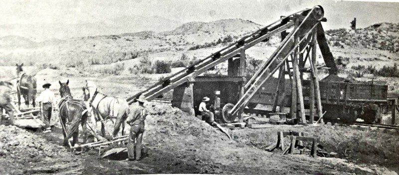 Bullionville, Nevada, Horse-driven slip scrapers retrieve tailings to dump onto a conveyor and then dropped into a freight car. Before 1880