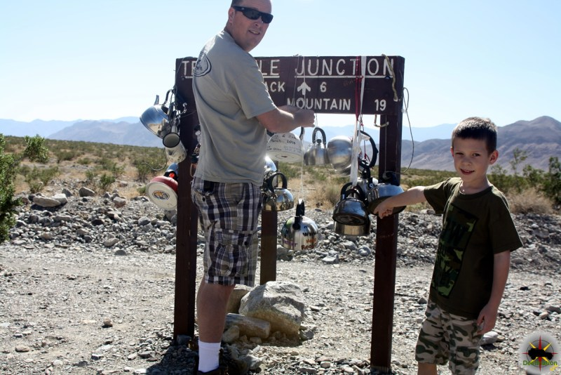 Ryan and I hanging our teakettle at the sign.
