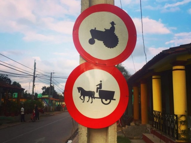 Road signs in Viñales, Cuba show that it's still very much a small, farming town!